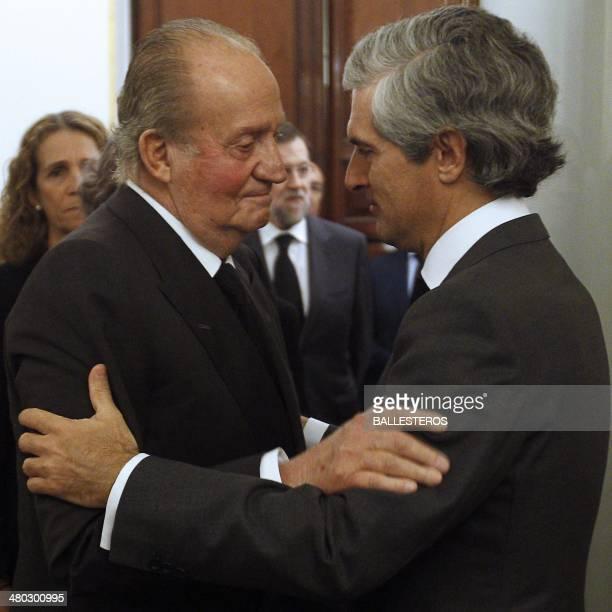 Spain's King Juan Carlos offers his condolences to former Spanish Prime Minister Adolfo Suarez's son Adolfo Suarez Illana as he arrives at the chapel...