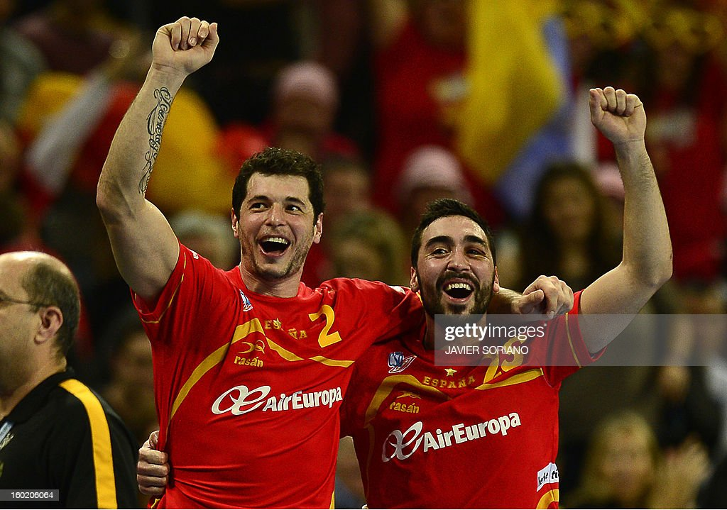 Spain's left back Alberto Entrerrios (L) and Spain's left wing Valero Rivera celebrate their victory just before the end of the 23rd Men's Handball World Championships final match Spain vs Denmark at the Palau Sant Jordi in Barcelona on January 27, 2013.