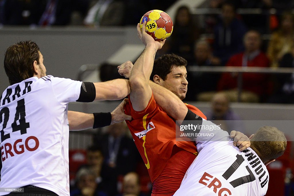 Spain's left back Alberto Entrerrios vies with Germany's centre back Michael Haas and Germany's right wing Steffen Weinhold during the 23rd Men's...