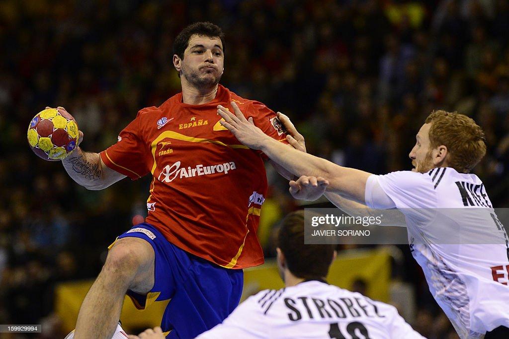 Spain's left back Alberto Entrerrios vies with Germany's pivot Patrick Wiencek during the 23rd Men's Handball World Championships quarterfinal match...