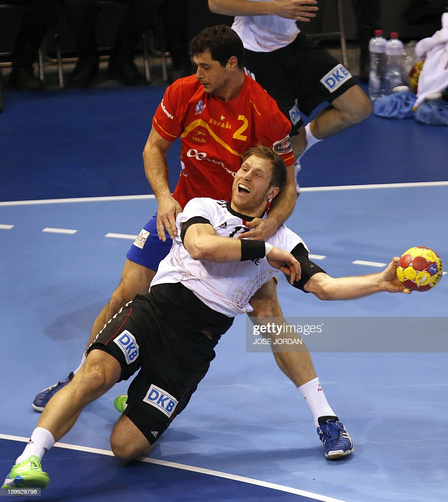 Spain's left back Alberto Entrerrios vies with Germany's right wing Steffen Weinhold during the 23rd Men's Handball World Championships quarterfinal...