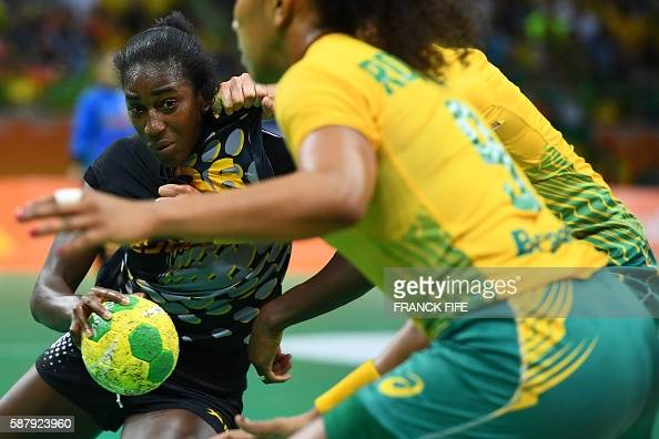 TOPSHOT Spain's left back Alexandrina Cabral Barbosa vies with a Brazilian player during the women's preliminaries Group A handball match Brazil vs...