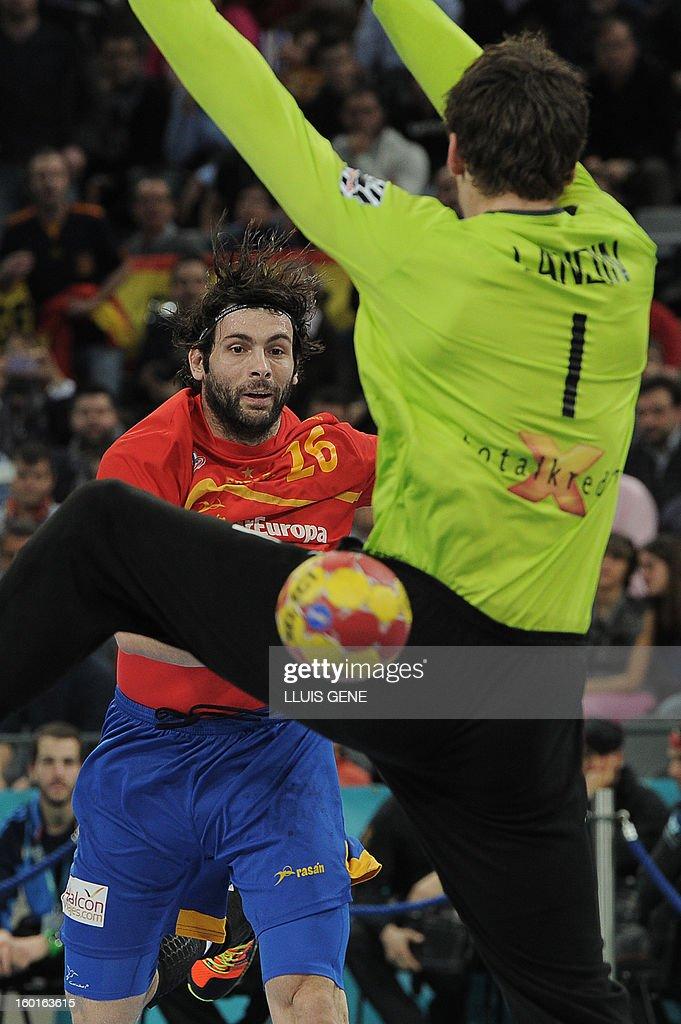 Spain's left back Antonio Jesus Garcia (Back) shoots at Denmark's goalkeeper Niklas Landin during the 23rd Men's Handball World Championships final match Spain vs Denmark at the Palau Sant Jordi in Barcelona on January 27, 2013.
