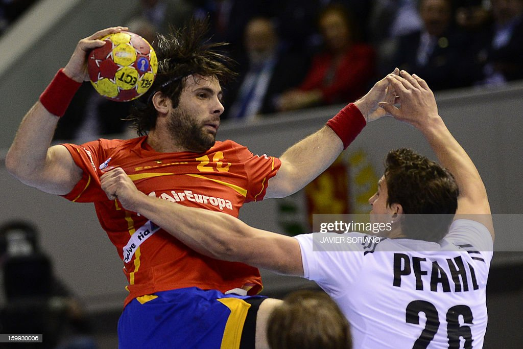 Spain's left back Antonio Jesus Garcia vies with Germany's right back Adrian Pfahl during the 23rd Men's Handball World Championships quarterfinal...