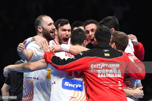 TOPSHOT Spain's left back Joan Canellas and his teammates celebrate winning the 25th IHF Men's World Championship 2017 eighth final handball match...