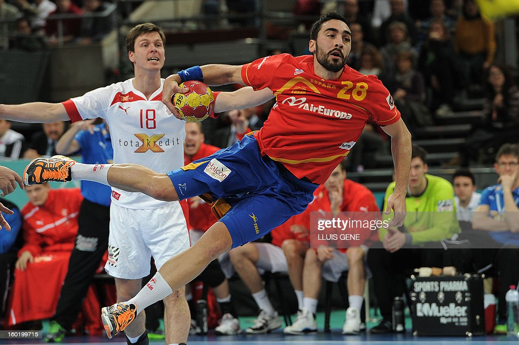 Spain's left wing Valero Rivera jumps to shoot during the 23rd Men's Handball World Championships final match Spain vs Denmark at the Palau Sant Jordi in Barcelona on January 27, 2013. AFP PHOTO/ LLUIS GENE