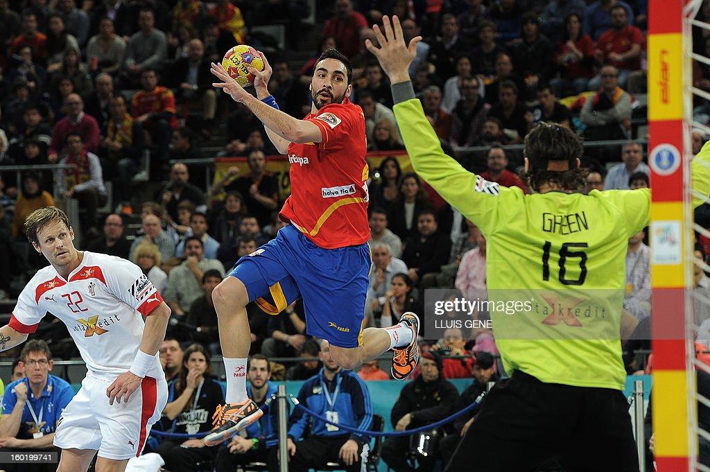 Spain's left wing Valero Rivera (C) jumps to shoot during the 23rd Men's Handball World Championships final match Spain vs Denmark at the Palau Sant Jordi in Barcelona on January 27, 2013.
