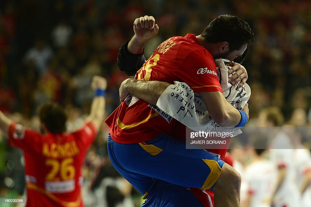 Spain's left wing Valero Rivera reacts as he celebrates with a teammate their victory at the end of the 23rd Men's Handball World Championships final match Spain vs Denmark at the Palau Sant Jordi in Barcelona on January 27, 2013. Spain won 35-19. AFP PHOTO/ JAVIER SORIANO