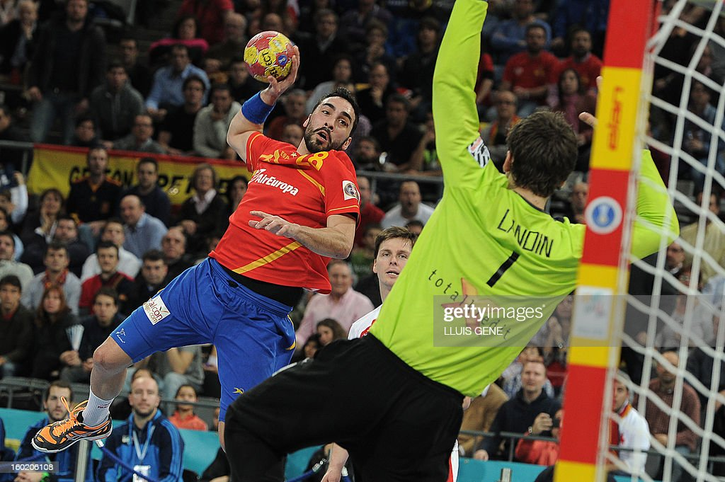 Spain's left wing Valero Rivera (L) shoots at Denmark's goalkeeper Niklas Landin during the 23rd Men's Handball World Championships final match Spain vs Denmark at the Palau Sant Jordi in Barcelona on January 27, 2013.