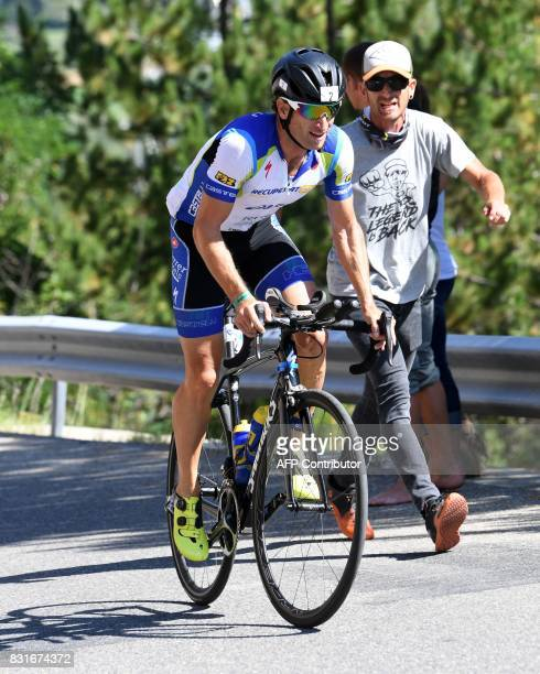 Spain's Maecel Zamora rides through the Col d'Izoard mountain pass during the cycling portion of the 34th edition of the Ironman triathlon on August...