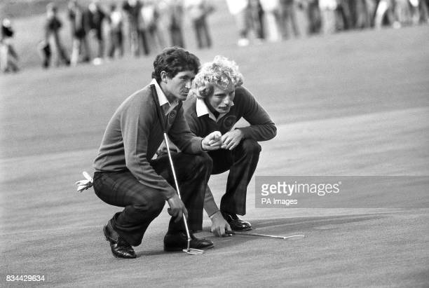 Spain's Manuel Pinero left and his West German partner Bernhard Langer discuss the lie of the ball during their fourball against Americans Ray Floyd...