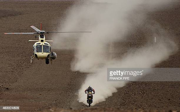 Spain's Marc Coma on KTM competes in the 2014 Dakar Rally Stage 12 between El Salvador and La Serena in Chile on January 17 2014 AFP PHOTO / FRANCK...