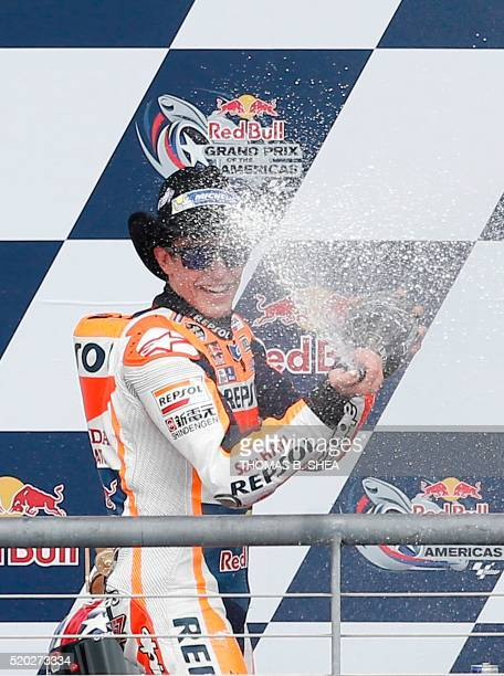 Spain's Marc Marquez celebrates his victory in the 2016 Grand Prix of the Americas MotoGP race at Circuit of the Americas in Austin Texas on April 10...