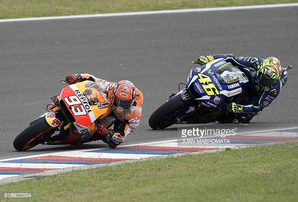 Spain's Marc Marquez of Honda rides ahead of Italy's Valentino Rossi of Yamaha during the MotoGP race of the Argentina Grand Prix at Termas de Rio...