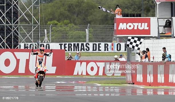 Spain's Marc Marquez on Honda celebrates after winning the MotoGP race of the Argentina Grand Prix at the Termas de Rio Hondo circuit in Santiago del...