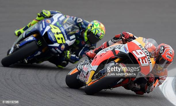 Spain's Marc Marquez on Honda rides ahead of Italy's Valentino Rossi on Yamaha during the MotoGP race of the Argentina Grand Prix at Termas de Rio...