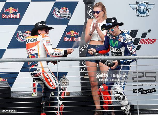 Spain's Marc Marquezcelebrates his win by spraying champagne on Spain's Jorge Lorenzo who finished second after competing in the 2016 Grand Prix of...