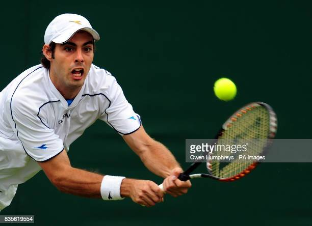 Spain's Marcel Granollers in action during the 2009 Wimbledon Championships at the All England Lawn Tennis and Croquet Club Wimbledon London