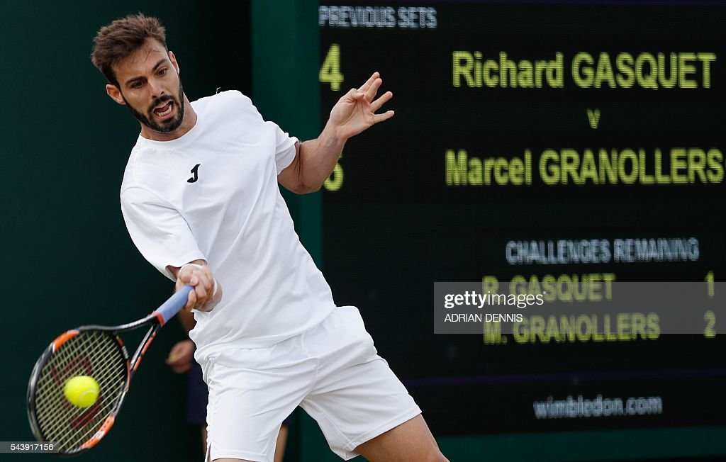 Spain's Marcel Granollers returns against France's Richard Gasquet during their men's singles second round match on the fourth day of the 2016 Wimbledon Championships at The All England Lawn Tennis Club in Wimbledon, southwest London, on June 30, 2016. / AFP / ADRIAN