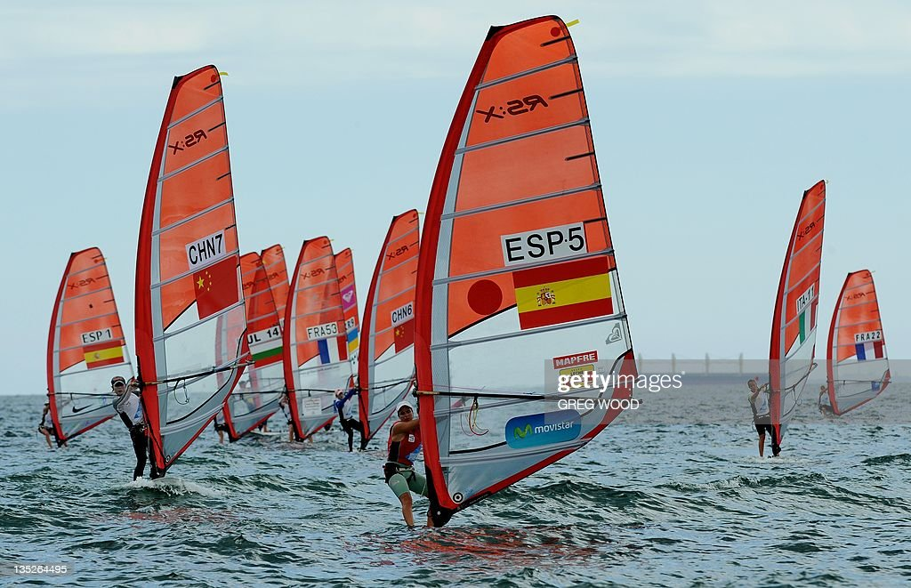 Spain's Marina Alabau (C) competes in the first Gold Fleet race in the