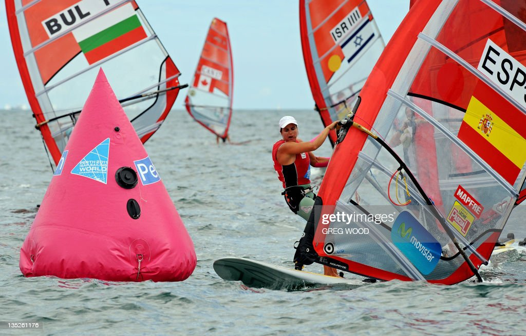Spain's Marina Alabau (R) rounds a mark in the first Gold Fleet race in the