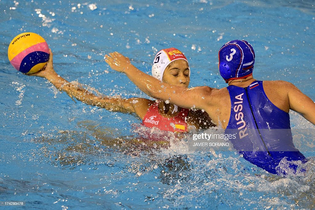 Spain's Matilde Ortiz (L) vies with Russia's Ekaterina Prokofyeva (R) during the preliminary round match between Spain and Russia in the women's water polo competition at the FINA World Championships in Bernat Picornell pools in Barcelona on July 23, 2013.