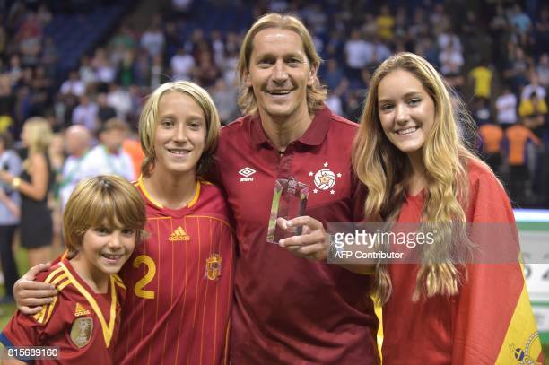 Spain's Michel Salgado poses with his award after being named top scorer during the Star Sixes final football match between France and Denmark at the...