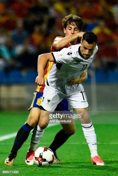 Spain's midfielder Alvaro Odriozola vies with Albanian's defender Azdren LLullaku during the World Cup 2018 qualifier football match Spain vs Albania...
