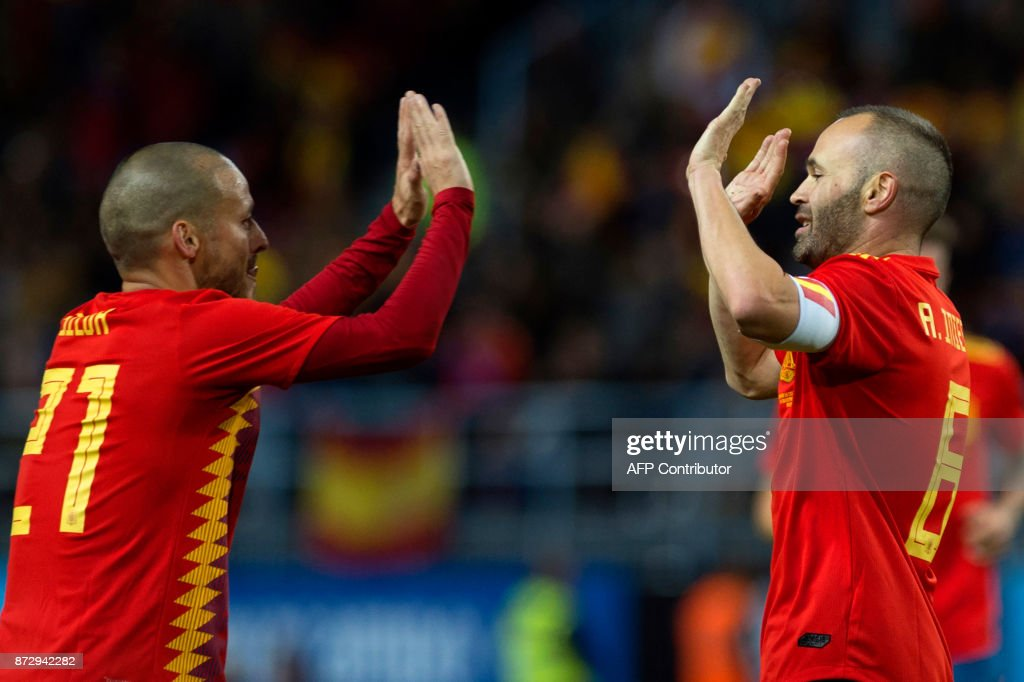 Spain's midfielder Andres Iniesta (R) celebrates with midfielder David Silva after scoring during the international friendly football match Spain against Costa Rica at La Rosaleda stadium in Malaga on November 11, 2017. /