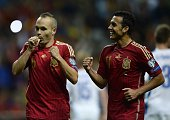 Spain's midfielder Andres Iniesta celebrates with Spain's forward Pedro Rodriguez after scoring a goal during the Euro 2016 qualifying football match...