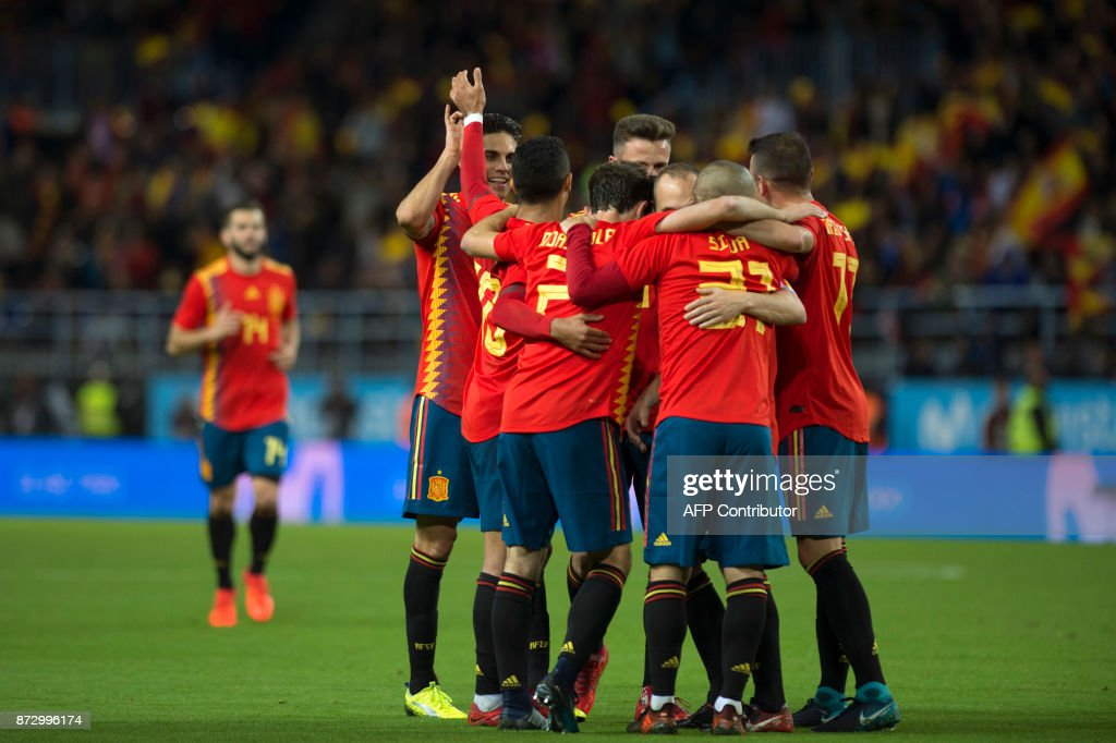 Spain's midfielder Andres Iniesta (C) celebrates with teammates after scoring during the international friendly football match Spain against Costa Rica at La Rosaleda stadium in Malaga on November 11, 2017. /