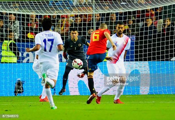 Spain's midfielder Andres Iniesta scores during the international friendly football match Spain against Costa Rica at La Rosaleda stadium in Malaga...