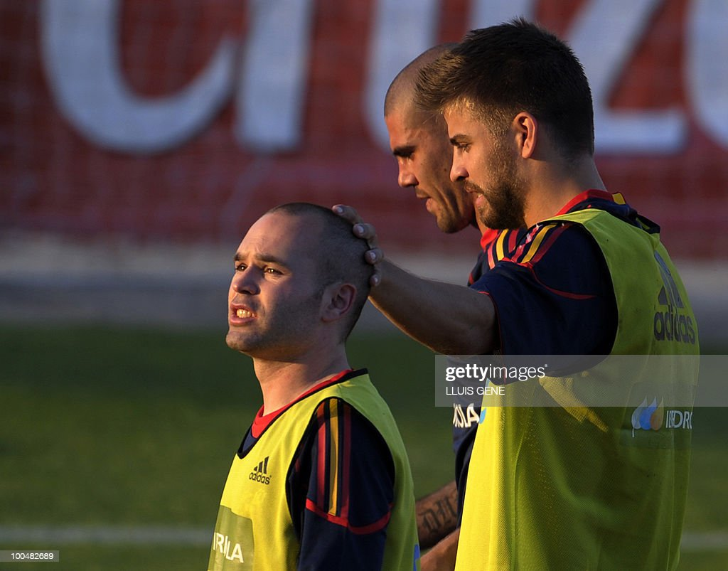 Spain's midfielder Andres Iniesta (L), Spain's defender Gerard Pique (R) and Spain's goalkeeper Victor Valdes (C) take part in a training session of the Spanish football team with Spain's Prince Felipe on May 24, 2010, at the Sports City of Las Rozas, near Madrid. Spain, among the favourites for the World Cup, which runs from June 11-July 11, face Switzerland, Honduras and Chile in Group H of the opening round.