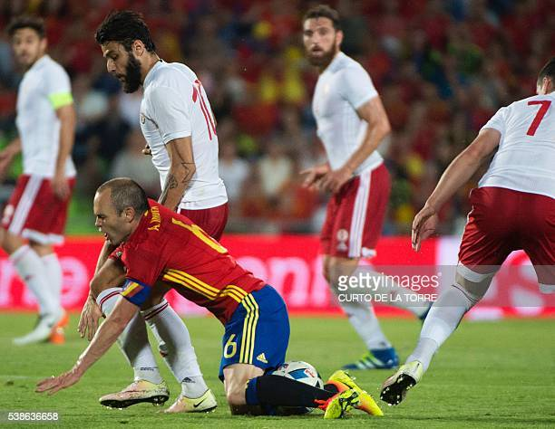 Spain's midfielder Andres Iniesta vies with Georgia's midfielder Tornike Okriashvili during the EURO 2016 friendly football match Spain vs Georgia at...