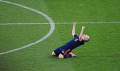 Spain's midfielder Andrés Iniesta celebrates at the end of the 2010 football World Cup final between the Netherlands and Spain on July 11 2010 at...
