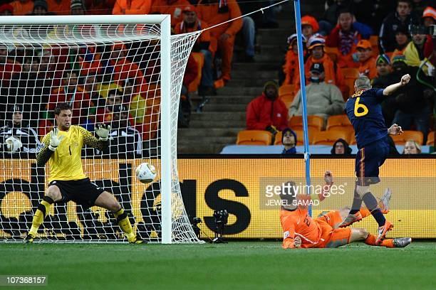 Spain's midfielder Andrés Iniesta shoots and scores a goal past Netherlands' goalkeeper Maarten Stekelenburg in extra time of the 2010 FIFA football...