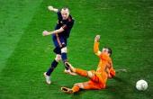 Spain's midfielder Andrés Iniesta shoots to score the game winning goal in extra time as Netherlands' midfielder Rafael van der Vaart tries to defend...
