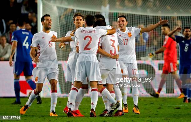 Spain's midfielder Asier Illarramendi celebrates his goal with his teammates during the Russia 2018 FIFA World Cup European Group G qualifying...