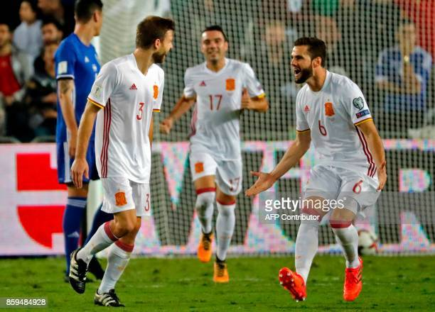 Spain's midfielder Asier Illarramendi celebrates his goal with Spain's forward Aritz Aduriz during the FIFA World Cup 2018 qualification football...