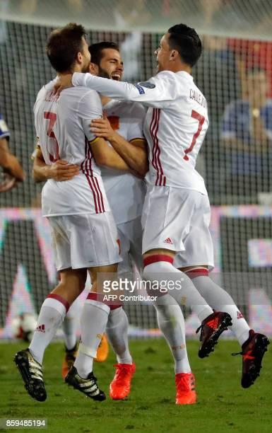 Spain's midfielder Asier Illarramendi celebrates his goal with Spain's forward Aritz Aduriz and Jose Callejon during the Russia 2018 FIFA World Cup...