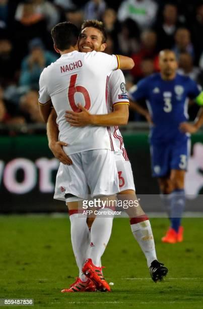 Spain's midfielder Asier Illarramendi celebrates his goal with Spain's forward Aritz Aduriz during the Russia 2018 FIFA World Cup European Group G...