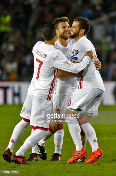 Spain's midfielder Asier Illarramendi reacts after scores during Russia 2018 FIFA World Cup European Group G qualifiers football match between Israel...