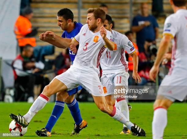 Spain's midfielder Asier Illarramendi vies for the ball with Israel's midfielder Marwan Kabha during the Russia 2018 FIFA World Cup European Group G...