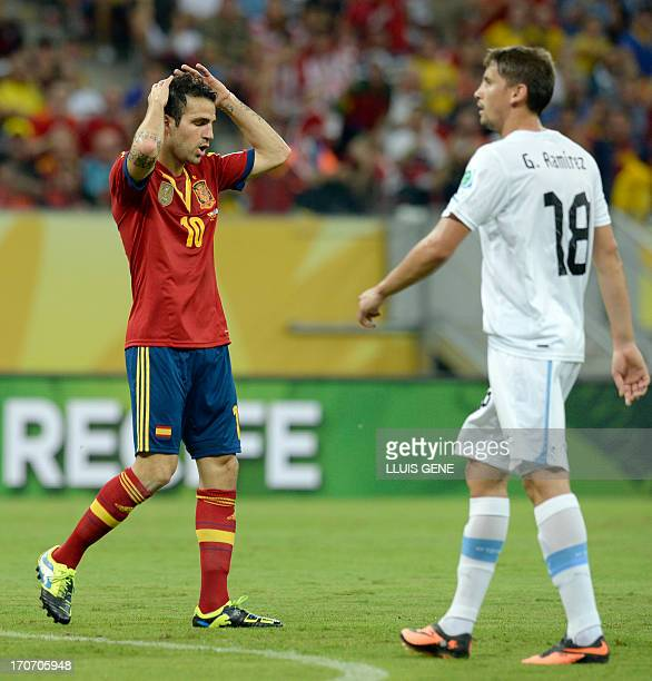 Spain's midfielder Cesc Fabregas gestures after missing a goal opportunity next to Uruguay's midfielder Gaston Ramirez during the FIFA Confederations...