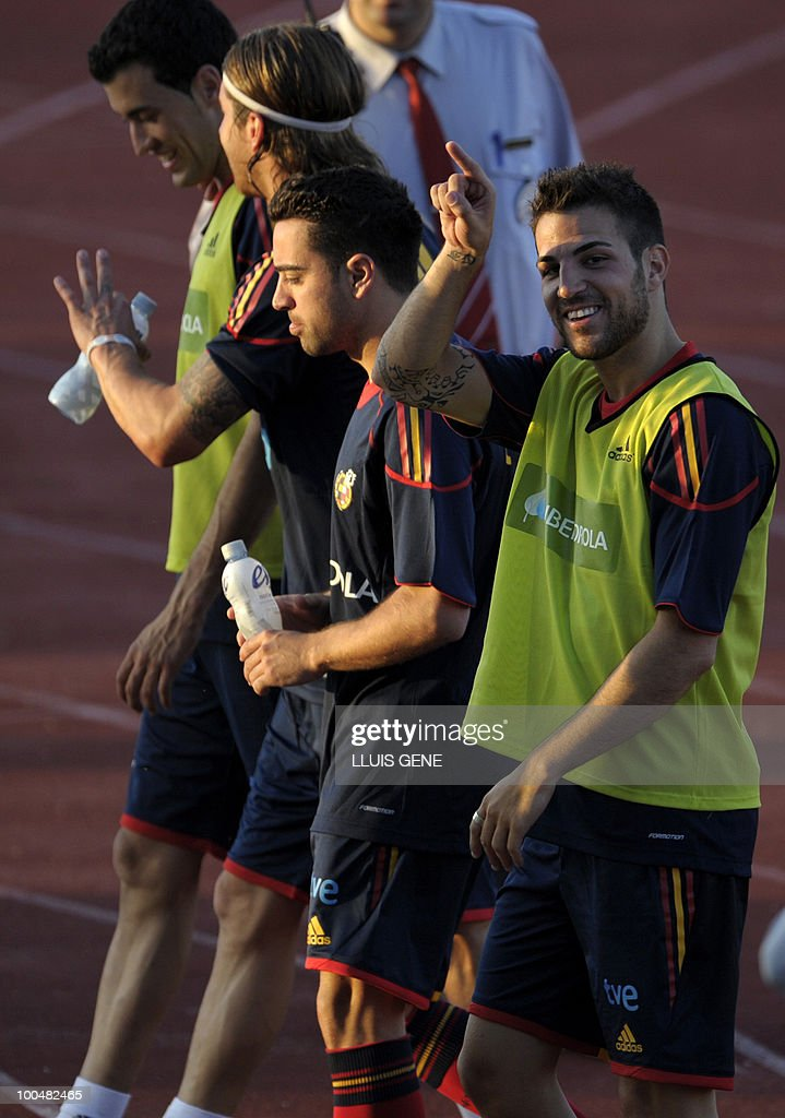 Spain's midfielder Cesc Fabregas, Spain's midfielder Xavi Hernandez, Spain's defender Sergio Ramos and Spain's midfielder Sergi Busquets take part in a training session of the Spanish football team with Spain's Prince Felipe on May 24, 2010, at the Sports City of Las Rozas, near Madrid. Spain, among the favourites for the World Cup, which runs from June 11-July 11, face Switzerland, Honduras and Chile in Group H of the opening round.