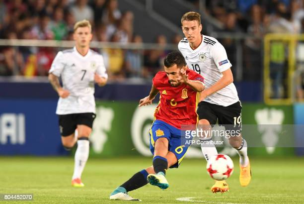 Spain's midfielder Dani Ceballos vies for the ball with Germany's forward Janik Haberer during the UEFA U21 European Championship football final...