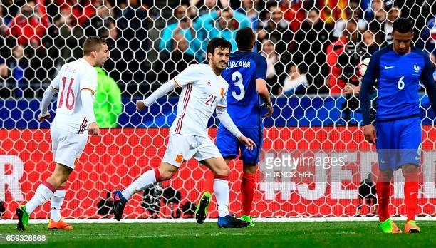 TOPSHOT Spain's midfielder David Silva celebrates after scoring a penalty during the friendly football match France vs Spain on March 28 2017 at the...