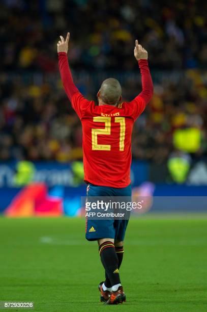 Spain's midfielder David Silva celebrates after scoring during the international friendly football match Spain against Costa Rica at La Rosaleda...