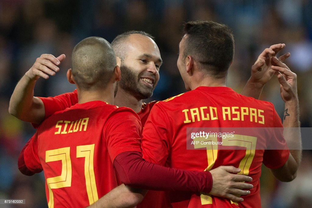 Spain's midfielder David Silva celebrates with midfielder Andres Iniesta and forward Iago Aspas after scoring during the international friendly football match Spain against Costa Rica at La Rosaleda stadium in Malaga on November 11, 2017. /