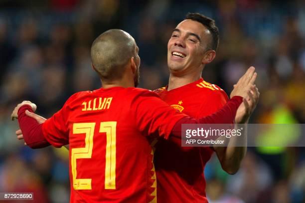 Spain's midfielder David Silva celebrates with Spain's forward Iago Aspas after scoring a goal during the international friendly football match Spain...